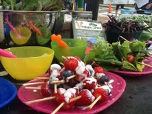kid power fruit kabobs at the market